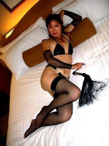 Asian MILF amateur Pussy in Fishnet Stockings.