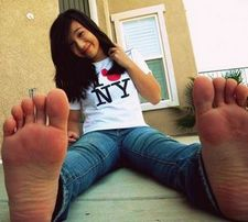 an asian hot girl in jeans with sexy soles.