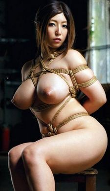 Hot asian big boobs in this incredible bondage photo.